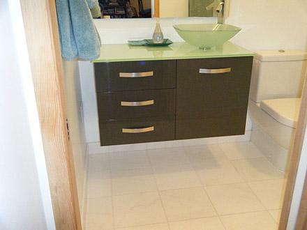 New vanity, vessel sink, and tile flooring.