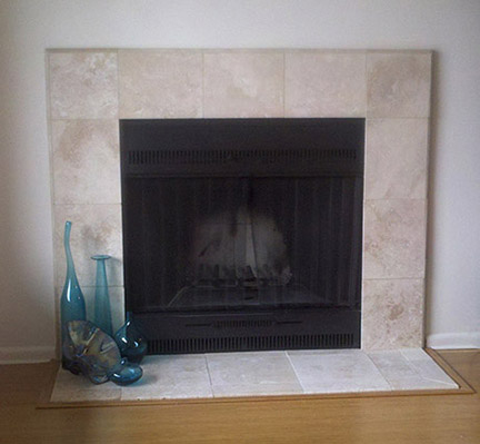 Updated fireplace by installing stone travertine.