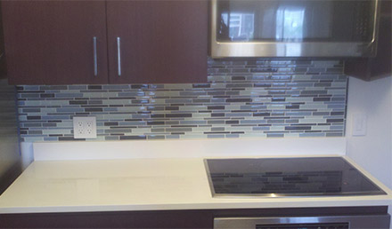 Installed glass backsplash as part of a full kitchen remodel.