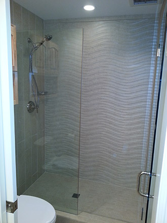 Wave texture tile as part of a full bathroom remodel.